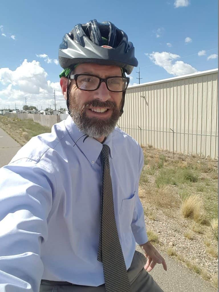 This image has an empty alt attribute; its file name is bike-commuting-lawyer-768x1024.jpg