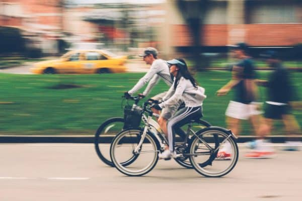 man and woman riding a bike together