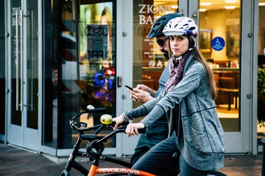 woman riding bike with helmet