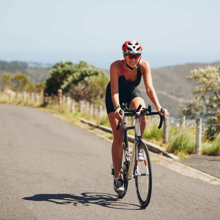 Woman cycling downhill