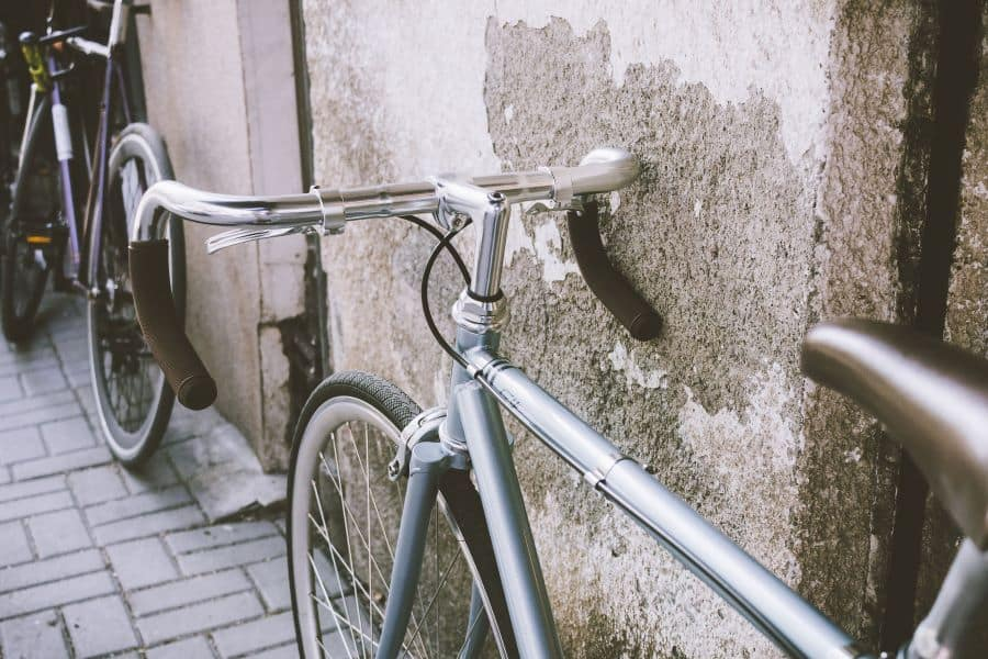 Road bikes by a wall