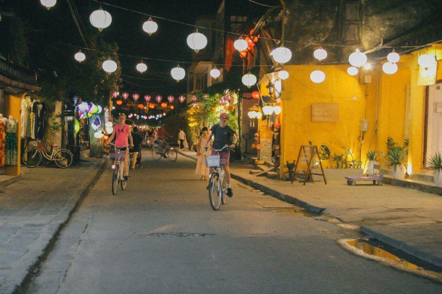 Two kids on bikes at night
