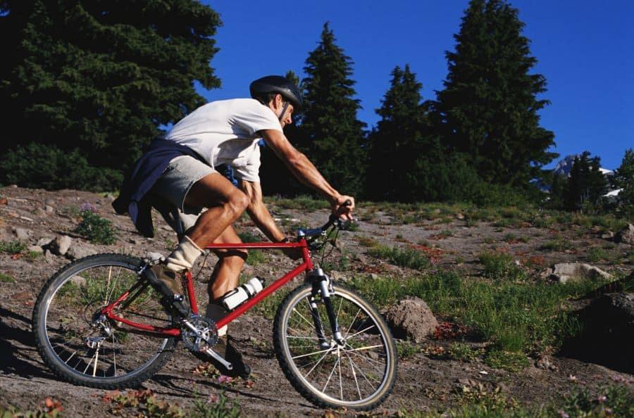 Man on mountain bike on rocky hillside
