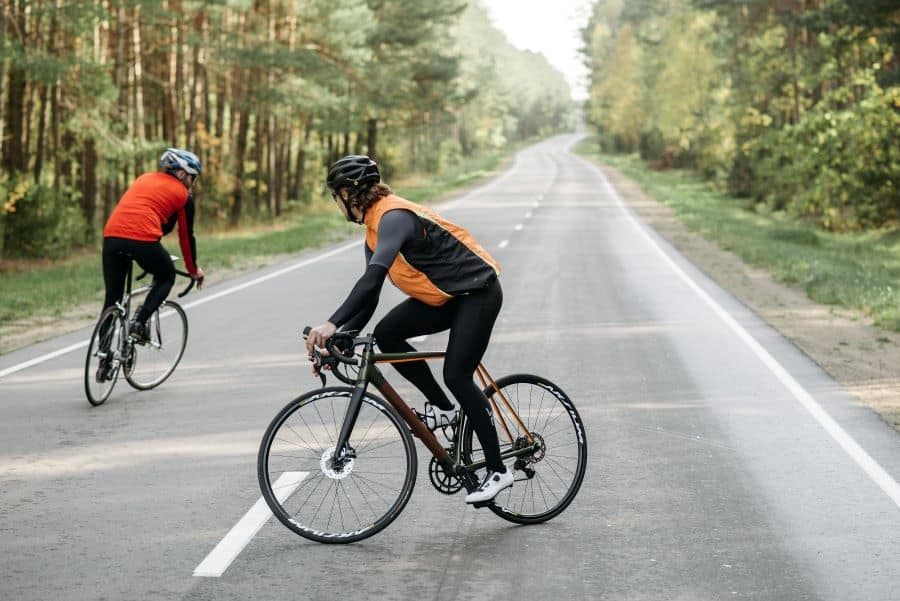 Two men on road bikes doing a circle in the road