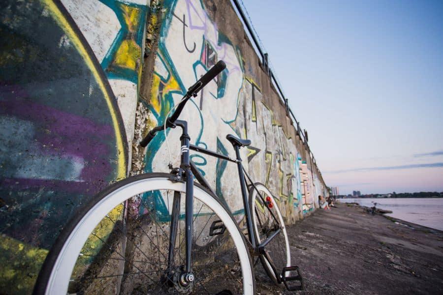 Road bike next to a graffiti wall