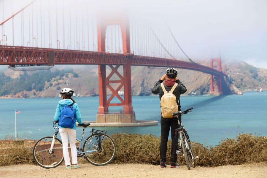 Two cyclists looking at Golden Gate Bridge