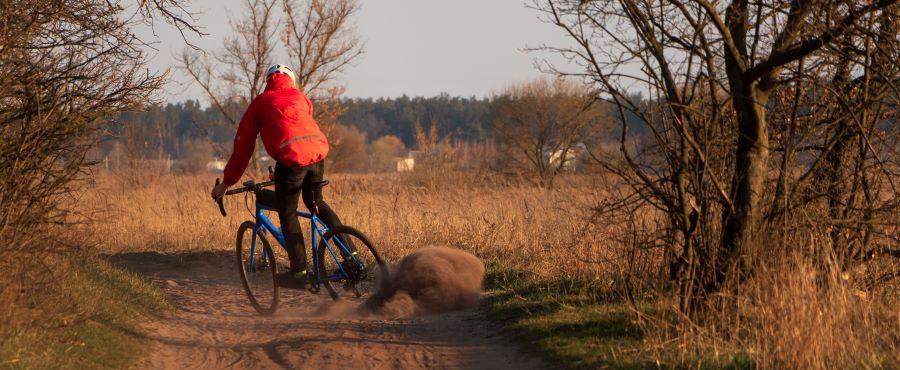 Man riding gravel bike on dirt track