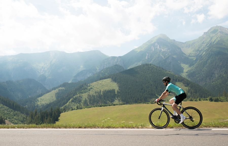 Man riding a road bike in the moutains