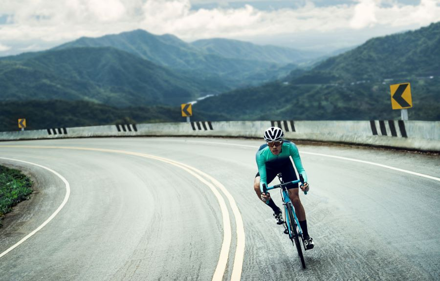 Riding a bike on the road in the mountains