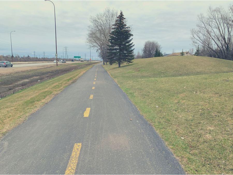 Flat road going alongside a freeway
