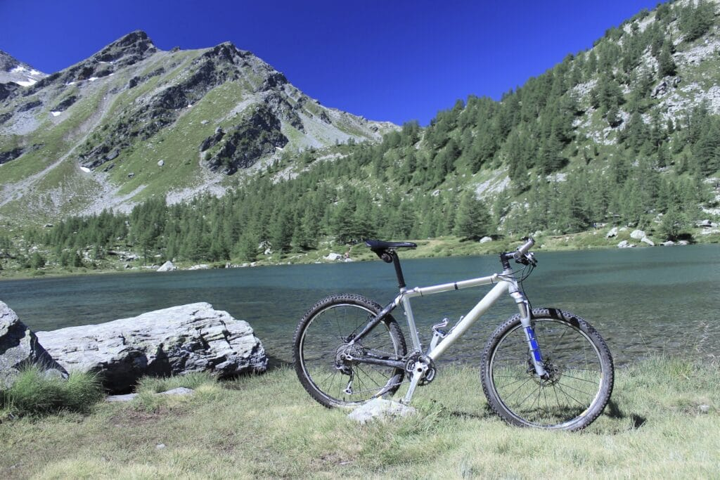Mountain bike in the mountains, parked by a rock